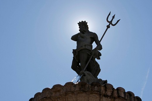 Statue of Neptune, Neptune Fountain backlit on the cathedral square in Trento, Northern Italy, Europe : Stock Photo