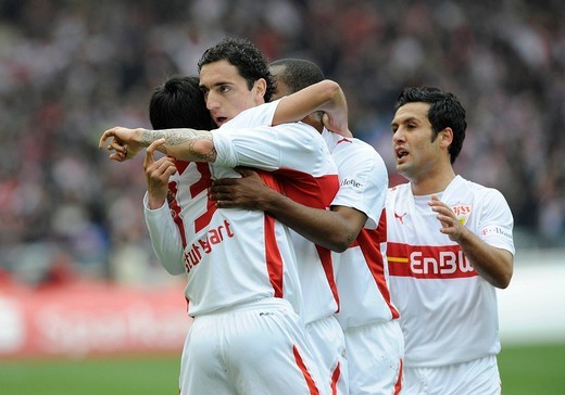 VfB Stuttgart football club players celebrating a goal, left to right: Pavel Pardo, Roberto Hilbert, Cacau and Yildiray Bastuerk Hilbert pointing at a tattoo on his forearm : Stock Photo
