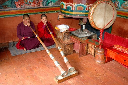 Nuns blowing into horns at a convent, Thimphu, Bhutan, Himalaya Mountains, Asia : Stock Photo