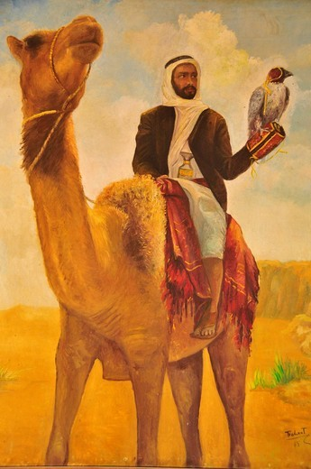 Picture of a falconer with falcon on a camel in the Al Ain Palace Museum, Al Ain, Abu Dhabi, United Arab Emirates, Arabia, the Orient, Middle East : Stock Photo