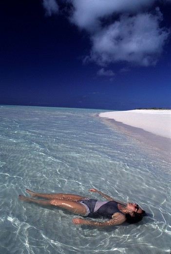 Woman in the low water at the beach Turks and Caicos Islands Bahamas Caribbean : Stock Photo