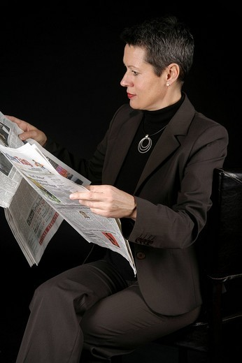 Stock Photo: 1848-191228 Woman reading newspaper