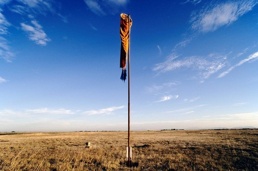 Limp windsock hanging from a pole in the veld of the Little Karoo in Western Cape, South Africa : Stock Photo