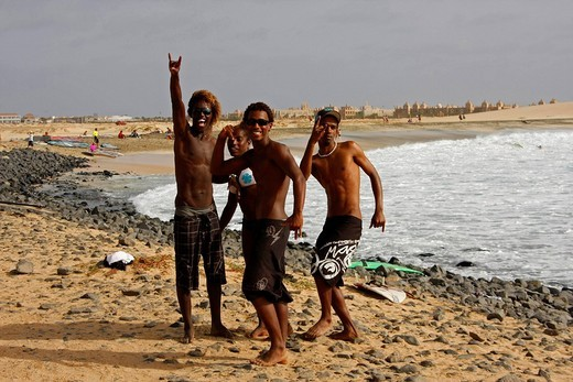 Cheerful youths on the beach outside the huge Riu Funana + Garopa Hotel, Sal Island, Cape Verde, Africa : Stock Photo