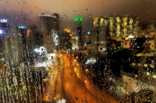 View of Canal Road and multiystory buildings through a rainy window, Wan Chai district at dusk, Hongkong, China, Asia : Stock Photo