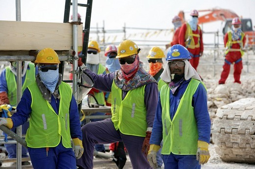 Workers on the construction site of Pearl GTL, Gas to Liquid, where the Shell company are constructing until 2010 the world_wide largest refinery for the production of liquid fuels from natural gas, Ras Laffan Industrial City, north of Doha, Qatar : Stock Photo