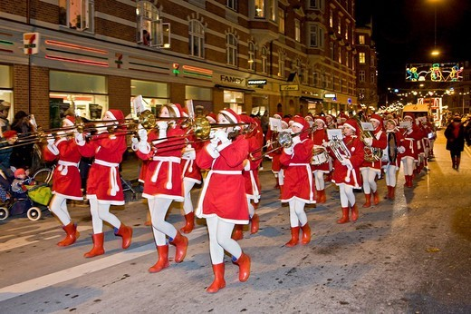 Christmas parade with young girls playing brass band music, Copenhagen, Denmark : Stock Photo