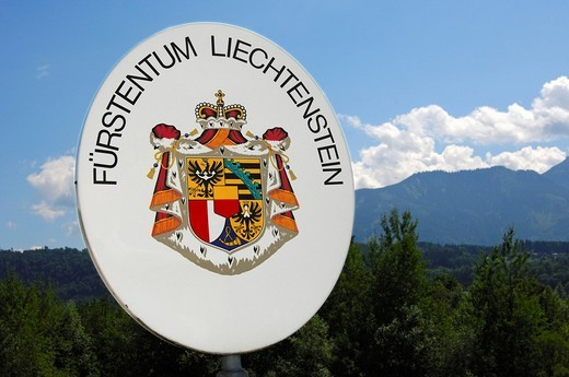 Demarcation of the national border, border sign with the Great Arms of the Nation, Principality of Liechtenstein : Stock Photo