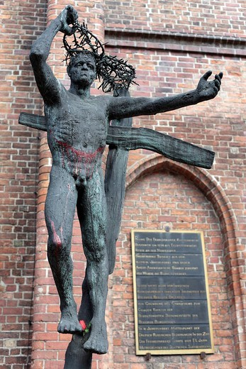 Freeing himself from the cross, sculpture by Fritz Cremer at the Klosterkirche Church, Berlin, Germany, Europe : Stock Photo