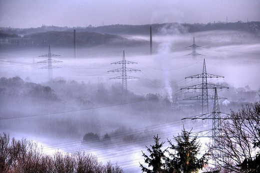 DEU Germany Bochum : High Voltage electrical power lines between Essen Bochum morning fog. , : Stock Photo
