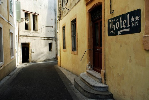 Stock Photo: 1848-195505 Abandoned two star hotel on a narrow street between old buildings in Arles, France