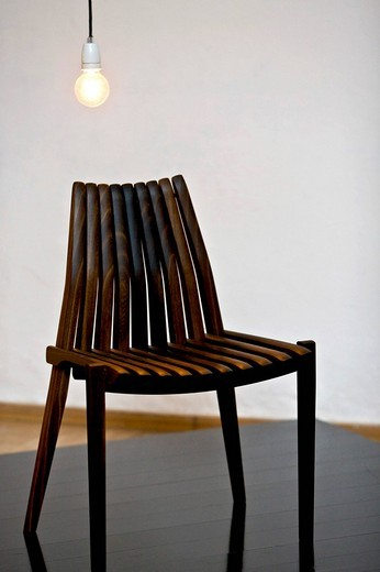 Modern wooden designer chair : Stock Photo