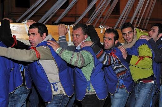 Cross bearers, men carrying heavy wooden cross, Lu Signuri di li fasci, Holy Week, Easter Procession, Pietraperzia, Sicily, Italy, Europe : Stock Photo