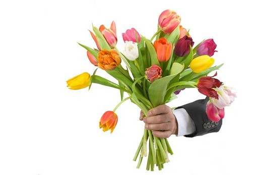Hand of a man holding out a colourful bunch of tulips as a present : Stock Photo