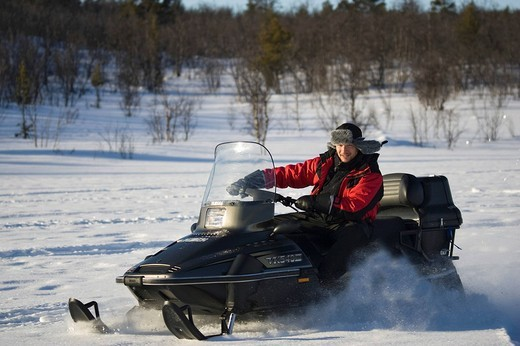 Stock Photo: 1848-198115 A snowmobile rider in Kiruna, North Sweden, Sweden