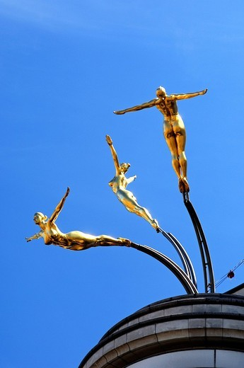 Stock Photo: 1848-200463 Three golden female nude statues diving from a roof above Piccadilly Circus, London, United Kingdom