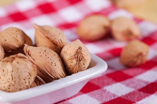 Stock Photo: 1848-200537 Almonds on red and white table cloth