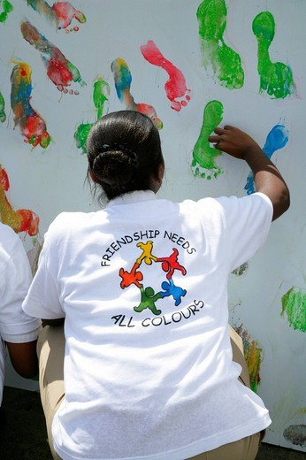 Multi_coloured footprints as a symbol of cooperation between people of various ethnic backgrounds during a protest against violence against women in Georgetown, Guyana, South America : Stock Photo
