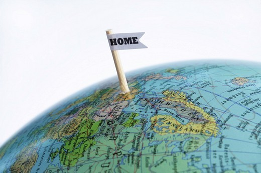 Globe with home country symbol : Stock Photo