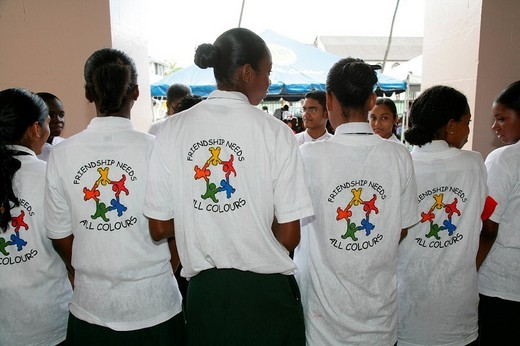 T_shirts showing symbol for cooperation between people of various ethnic backgrounds during a protest against violence against women in Georgetown, Guyana, South America : Stock Photo