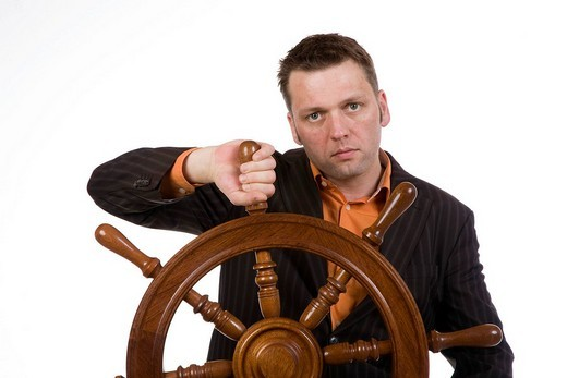 Stock Photo: 1848-20343 Manager with a steering wheel