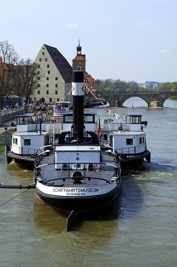 Maritime museum on Danube River, Historische Wurstkueche Restaurant and Steinerne Bruecke Bridge in the back, Regensburg, Upper Palatinate, Bavaria, Germany, Europe : Stock Photo