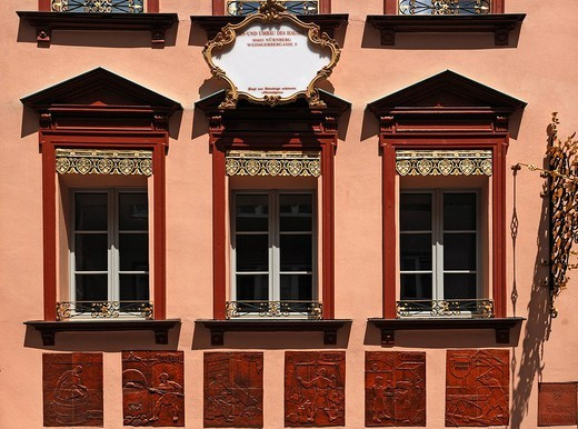 Decorative and renovated facade with tile reliefs of craftman´s trades in the historic town centre, Nuremberg, Middle Franconia, Bavaria, Germany, Europe : Stock Photo