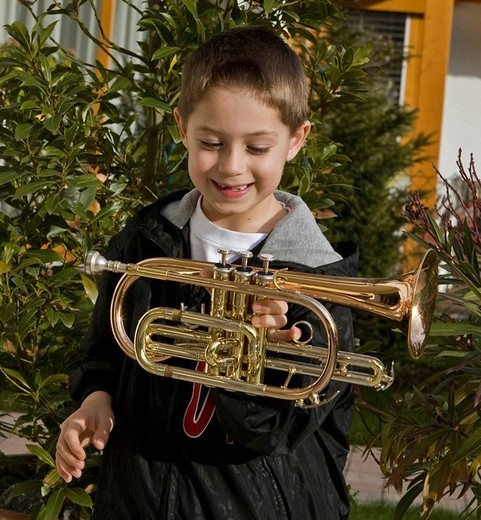 Tobias Krieger, 7 years old, from Sauerlach / Munich, Bavaria, Germany, is playing trumpet since he is 3 years old. He is one of the 10 finalists at the RTL show Supertalent with Dieter Bohlen. : Stock Photo
