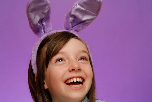 Young girl, age 9, wearing Easter bunny ears : Stock Photo