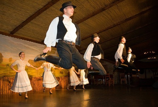 The folklore dance group Domjan is dancing in a Csarda, a traditional Hungarian tavern, Budapest, Hungary : Stock Photo