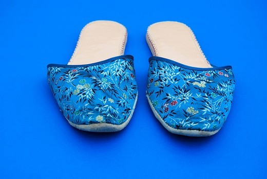 Blue slippers with flower pattern : Stock Photo