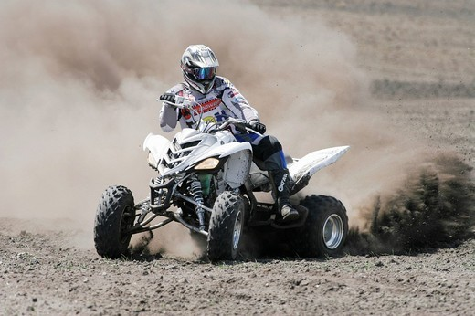Stock Photo: 1848-207657 Yamaha Quad driving off_road