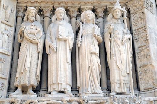 Saint statues, detail of the entrance portal of the Gothic cathedral Notre Dame de Paris, Paris, France, Europe : Stock Photo