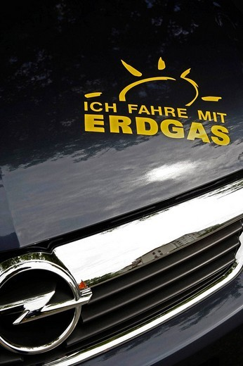 Stock Photo: 1848-208548 Advertising on an Opel car running on natural gas