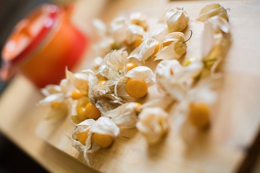 Physalis peruviana, cape gooseberries on a board : Stock Photo