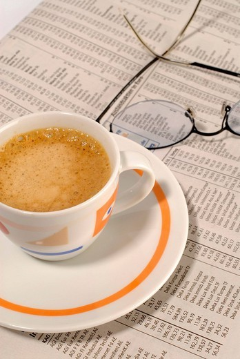 Espresso cup, newspaper and glasses : Stock Photo