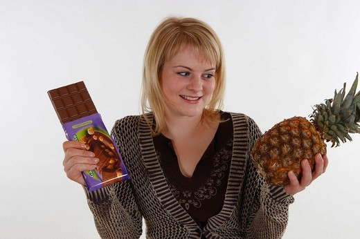 Woman with chocolate and a pineapple : Stock Photo