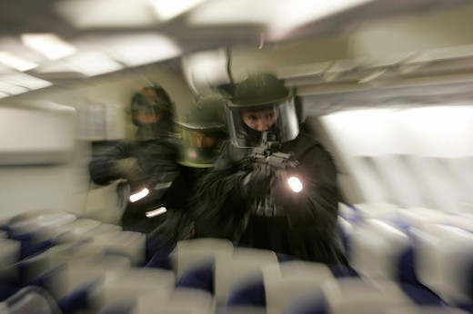 DEU, Germany, Duesseldorf : Police officers of a SWAT Team on a training misson in an airplane, in case of a highjacking. , : Stock Photo