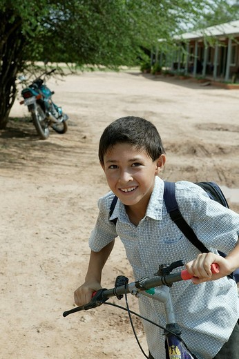 Boy with bicycle, Mennonite colony, Loma Plata, Chaco, Paragua, South America : Stock Photo