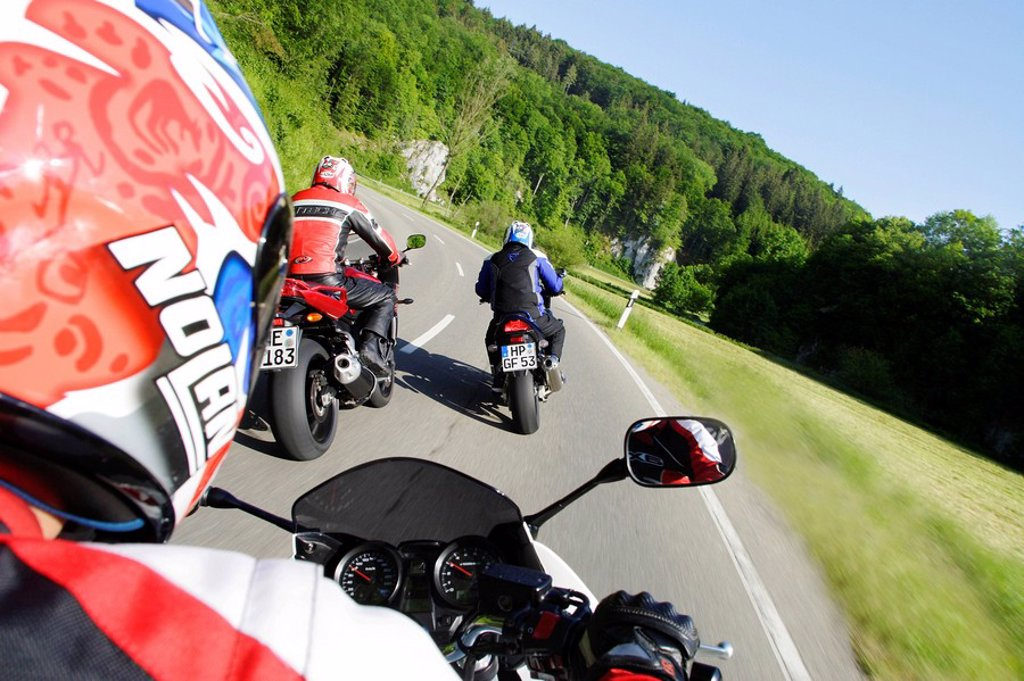 Stock Photo: 1848-211498 3 motorcyclists on the road
