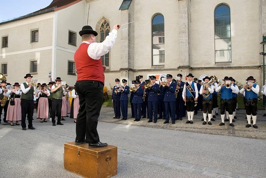 Bandleader conducting several bands simultaneously, Losenstein, Upper Austria, Austria, Europe : Stock Photo