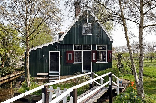Traditional Dutch wooden house with footbridge, open_air museum Zaanse Schans, Zaandam, North Holland, Netherlands, Europe : Stock Photo