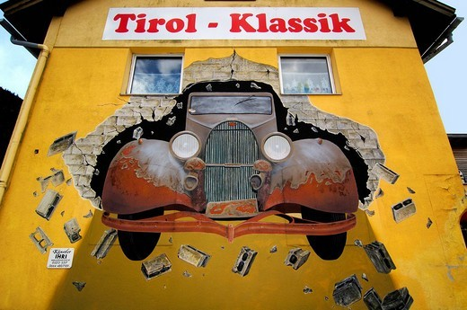 Stock Photo: 1848-213719 Tirol klassik classic airbrush www.tirol.at _ wallpainting, Oldtimer goes through wall, Scharnitz _ Tirol _ Austria