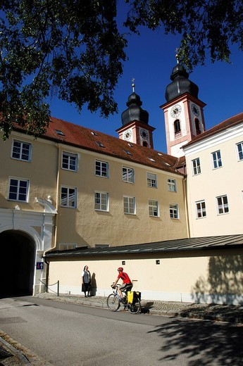Kloster Au, monastery, bicyclist and nun in front of it, Gars am Inn, Chiemgau, Bavaria, Germany, Europe : Stock Photo