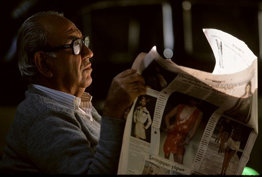 Man reads a newspaper, Cyprus : Stock Photo