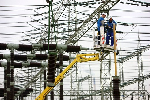 Stock Photo: 1848-215939 Workers doing maintenance work in a transformer station of the ELE, Emscher Lippe Energie GmbH, a subsiduary of the RWE, Marl, North Rhine_Westphalia, Germany, Europe