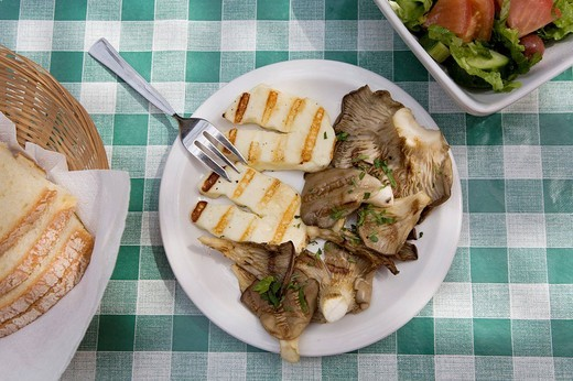 Typical halloumi cheese with mushrooms, Mese, various specialties served on small plates, tavern in the village Tochni, Cyprus, Greece, Europe : Stock Photo