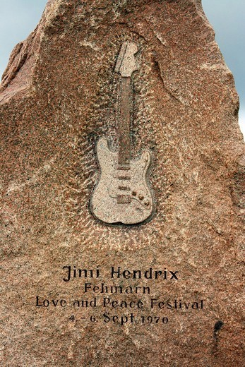 Memorial stone with inscription and relief of an electric guitar at the site of Jimi Hendrix´ last concert, Fehmarn, Schleswig_Holstein, Germany : Stock Photo