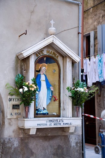 Statue of Mary on the wall of a building, Chioggia, Lagoon, Venice, Italy, Europe : Stock Photo
