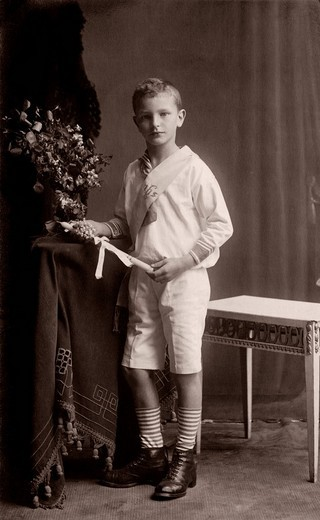 Stock Photo: 1848-218530 Boy during his First Communion, historical photograph, around 1910